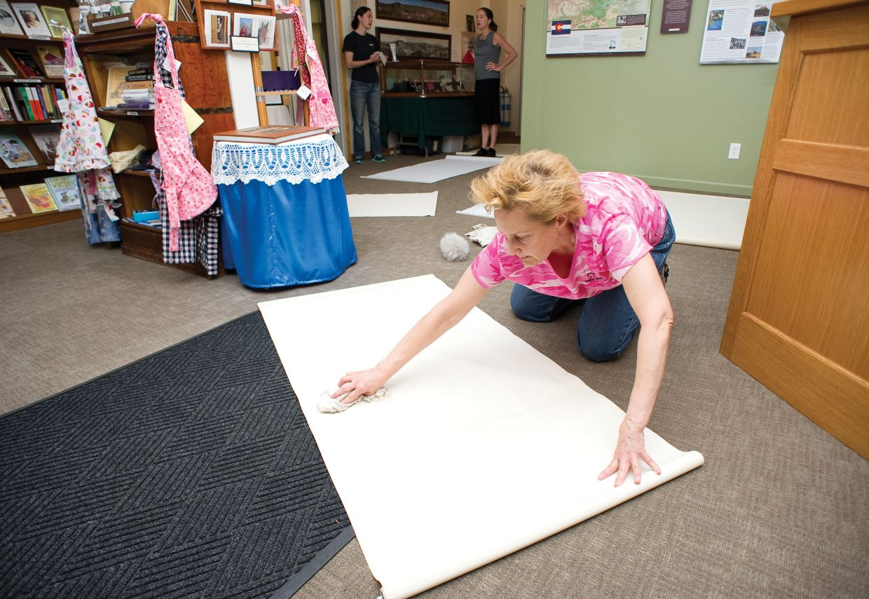 Volunteer Joni Strickland cleans blinds at the Tread of Pioneers Museum on Wednesday as part of Routt County United Way's Day of Caring.