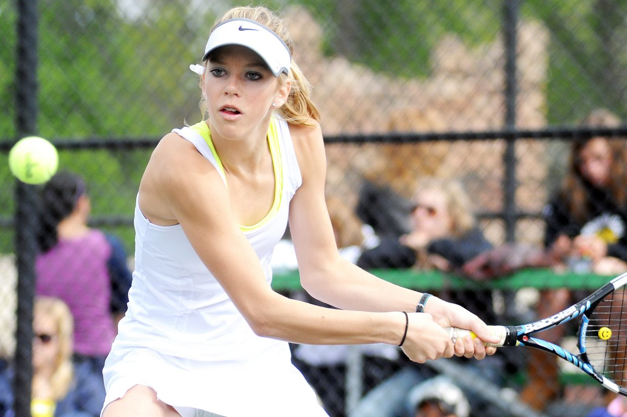 Rachel Grubbs eyes the ball on Saturday at the state tennis tournament in Pueblo. Grubbs and Lauren Siegel lost their No. 3 doubles match and placed fourth.
