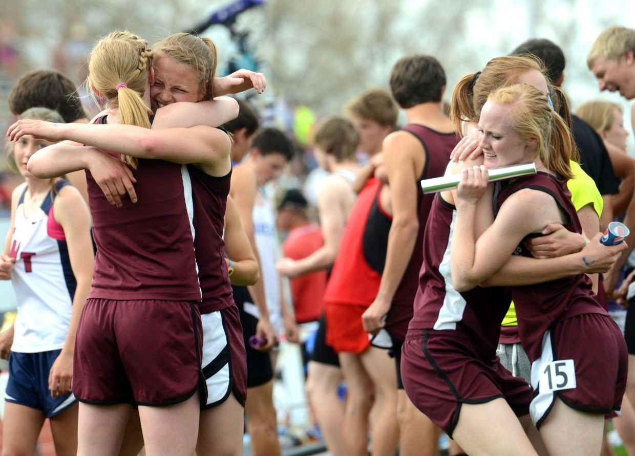 Soroco's 3,200-meter relay team of, from left, Leah Walorski, Jessica Rossi, Josie Rossi and Jaelyn Whaley celebrates after it learns it broke the school record in the event Thursday at the state track meet in Lakewood. The squad picked up a medal, finishing ninth.