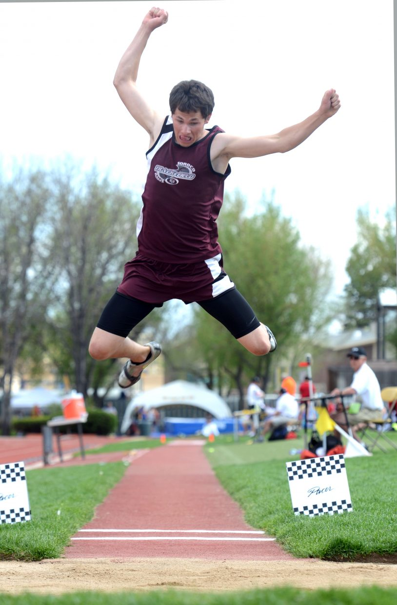 Nic Paxton flies in the long jump Thursday at the state track meet in Lakewood. Paxton finished sixth.