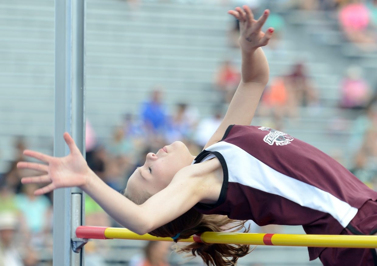 Kali Constine tries to clear the bar Thursday in the high jump at the state track meet in Lakewood.