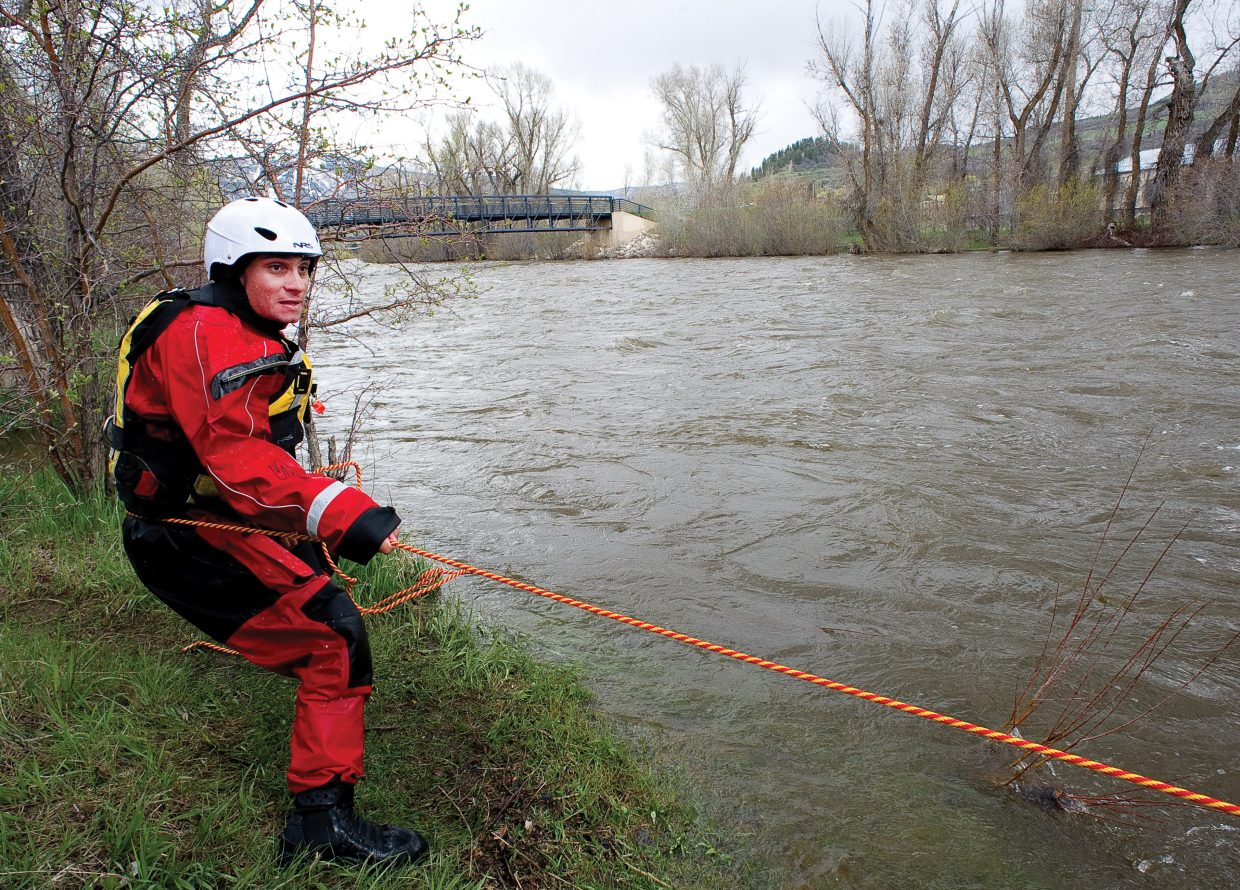 Steamboat Springs Fire Rescue member Tony DeRisio takes his turn helping a victim to shore during swift water training Thursday on the Yampa River.