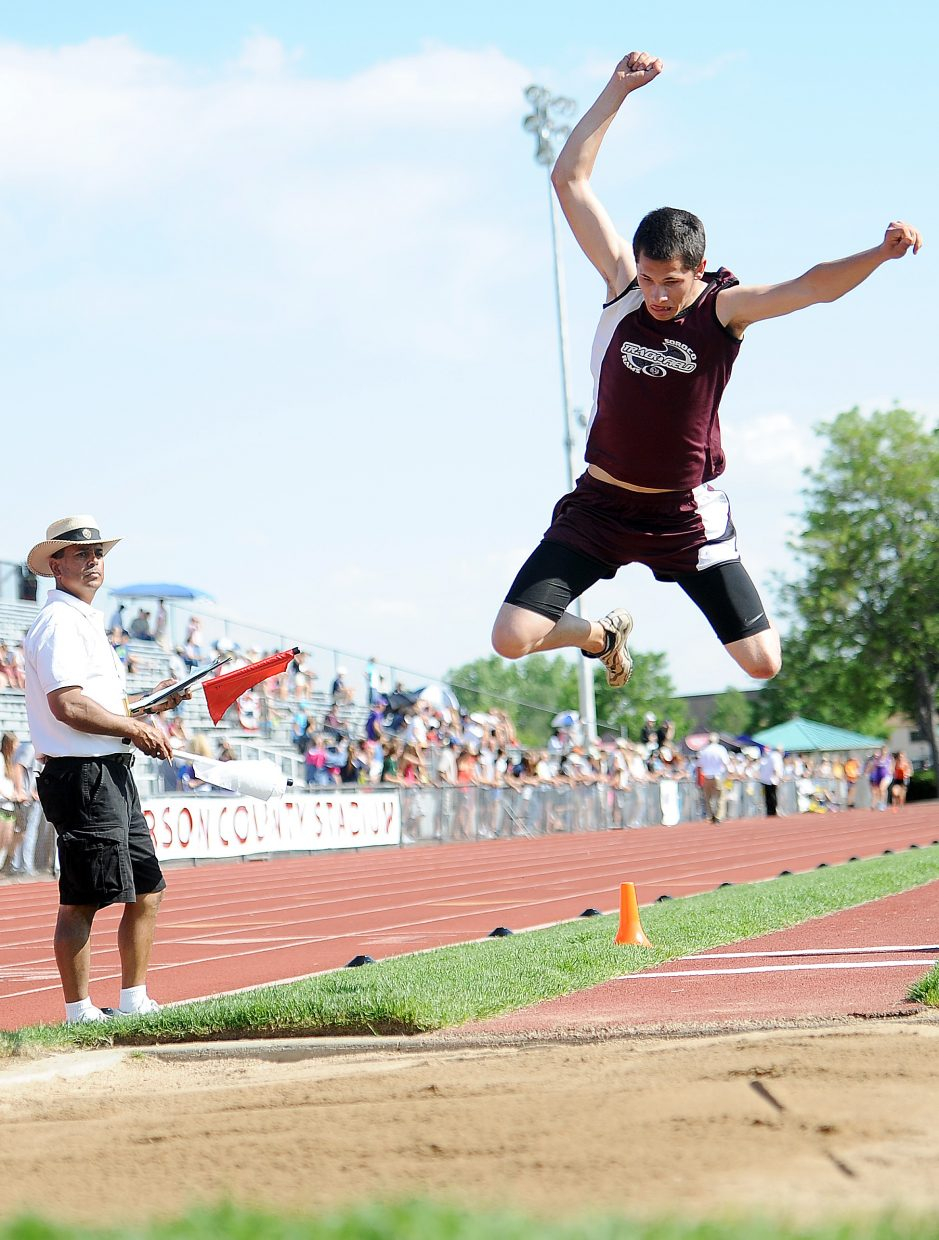 Soroco's Nic Paxton goes flying Thursday in the long jump competition at the state track meet in Lakewood.