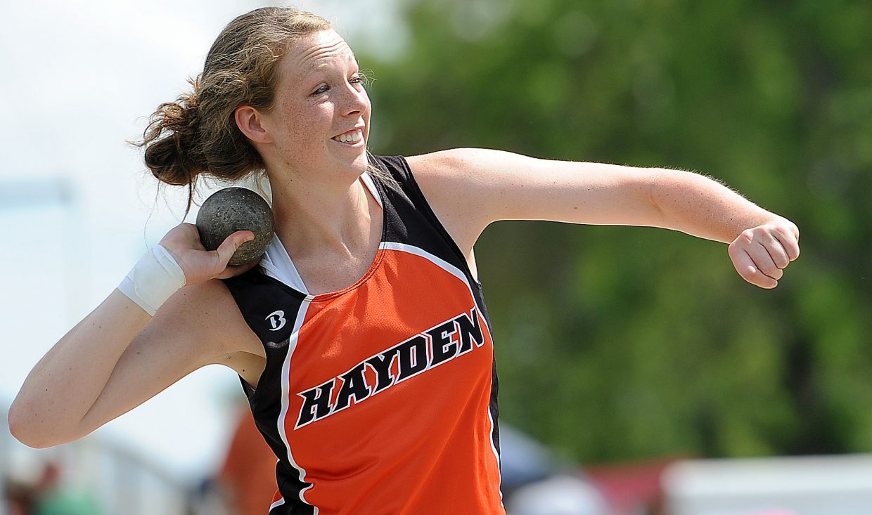 Hayden's Aubree Haskins launches the shotput Thursday at the state track meet in Lakewood.