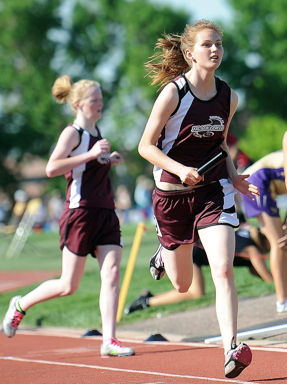 Soroco's Josie Rossi takes the baton Thursday in the girls 3,200 relay at the state track meet.