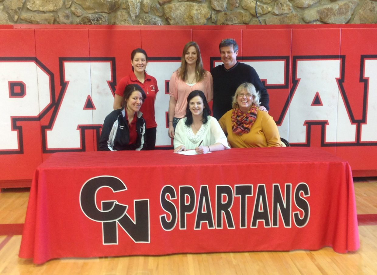 Soroco High School 2012 graduate Shelby Miles signs her letter of intent to play volleyball at Colorado Northwestern Community College in Rangely. Pictured sitting, from left, are head coach April Sanchez, Shelby Miles and mother Jane Miles. Standing, from left, are assistant coach Ariel Sanchez, sister Lindsay Miles and father Lance Miles.