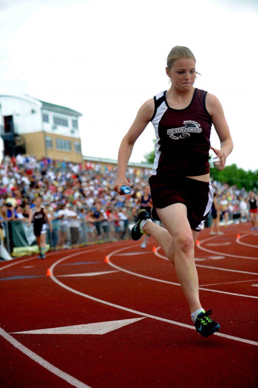 Soroco's Jessica Rossi runs Friday in the 1,600-meter relay at the state track meet in Lakewood.