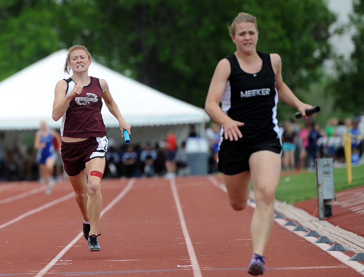 Soroco's Micaela Meyer runs toward the finish line Friday in the 800-meter relay at the state track meet in Lakewood.