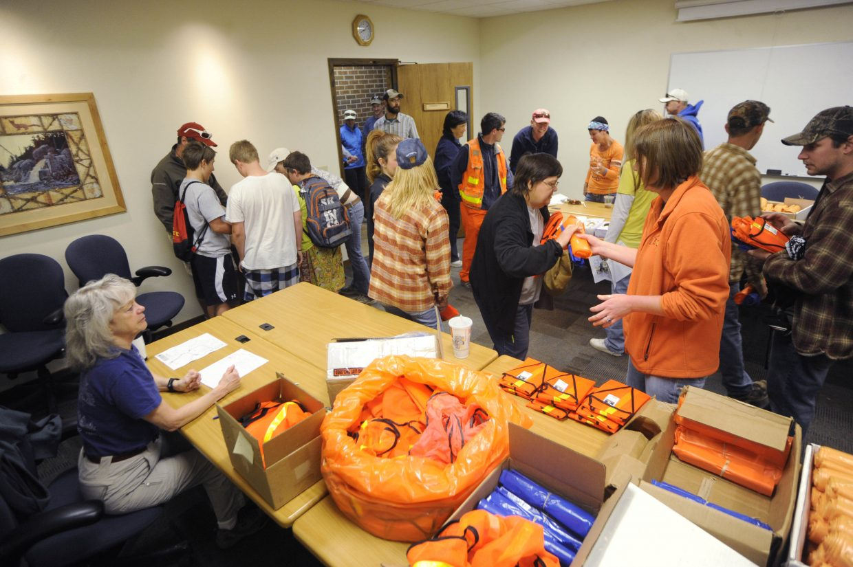 Volunteers check in and pick up supplies at the Routt County Courthouse on Saturday for Community Cleanup Day.