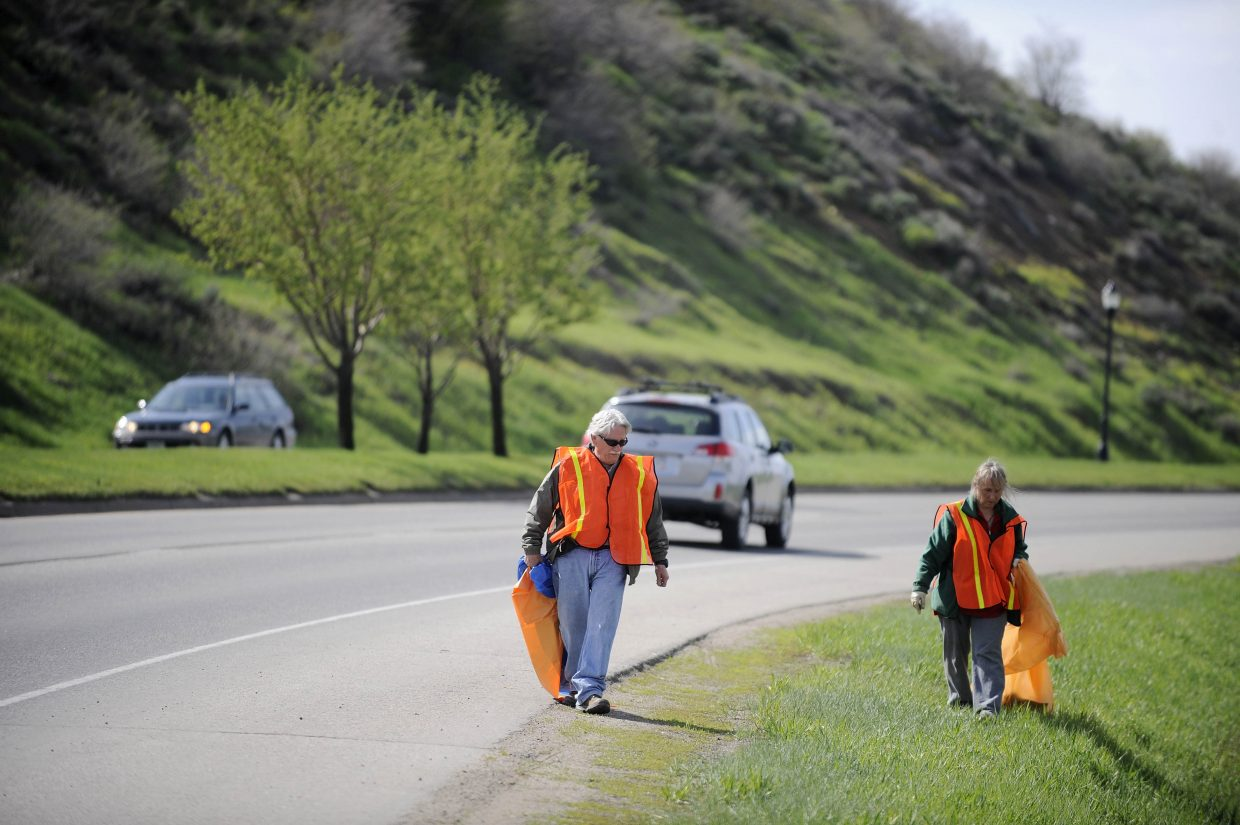 Routt County Manager Tom Sullivan and Ann Bronner pick up trash along U.S. Highway 40 on Saturday during Community Cleanup Day.