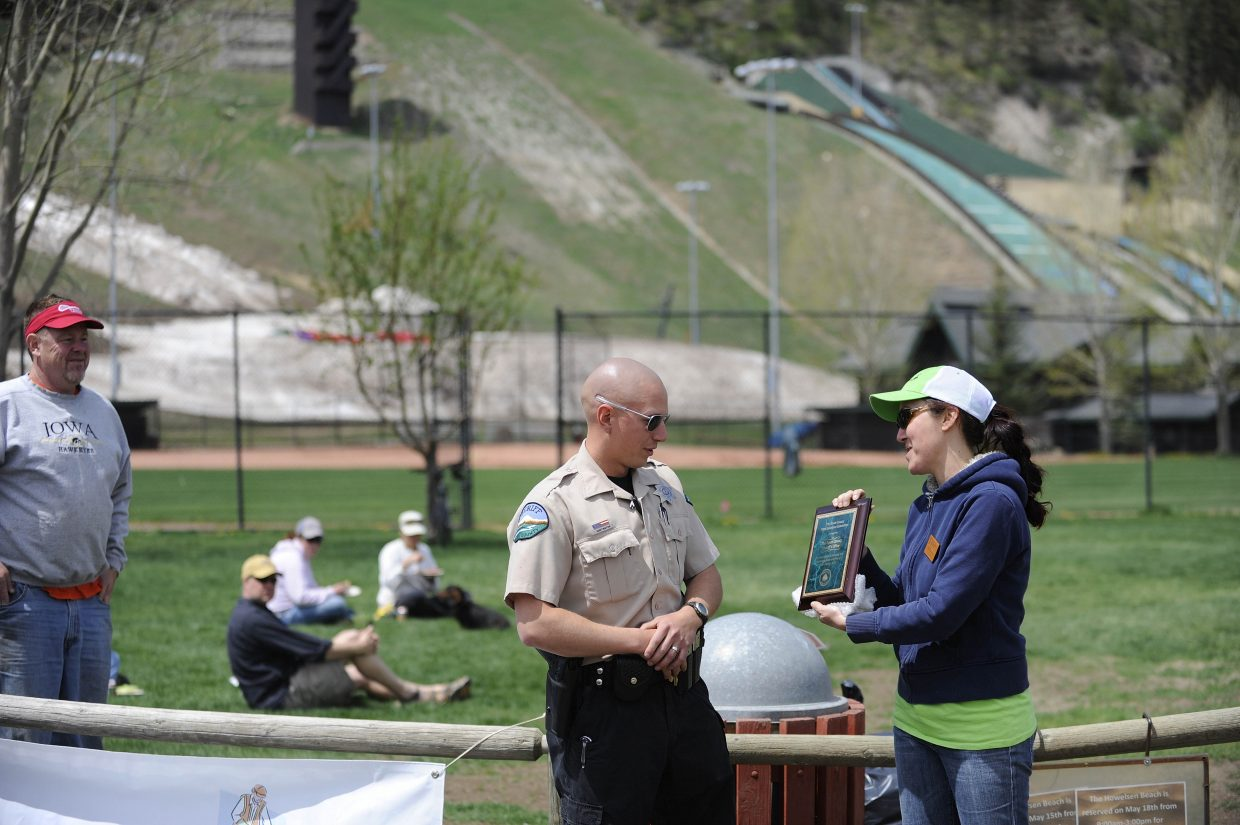 Yampa Valley Sustainability Council Program Director Andy Kennedy presents an award to Routt County Sheriff's Office Deputy Seth Huntington for the Sheriff's Office's efforts in picking up litter using inmates at the jail.