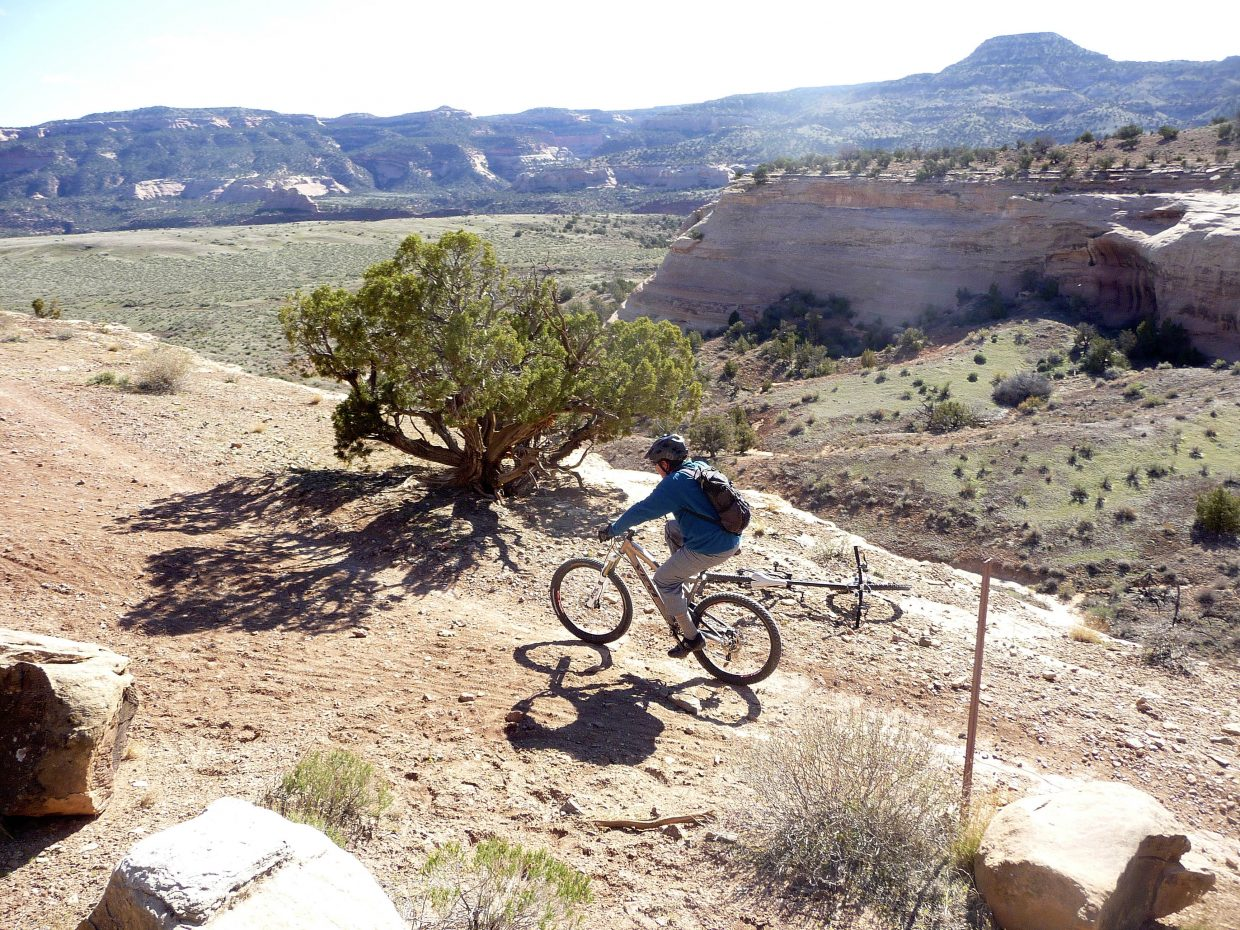 A cyclist rides along Mary's Loop in the Kokopelli Trail system.