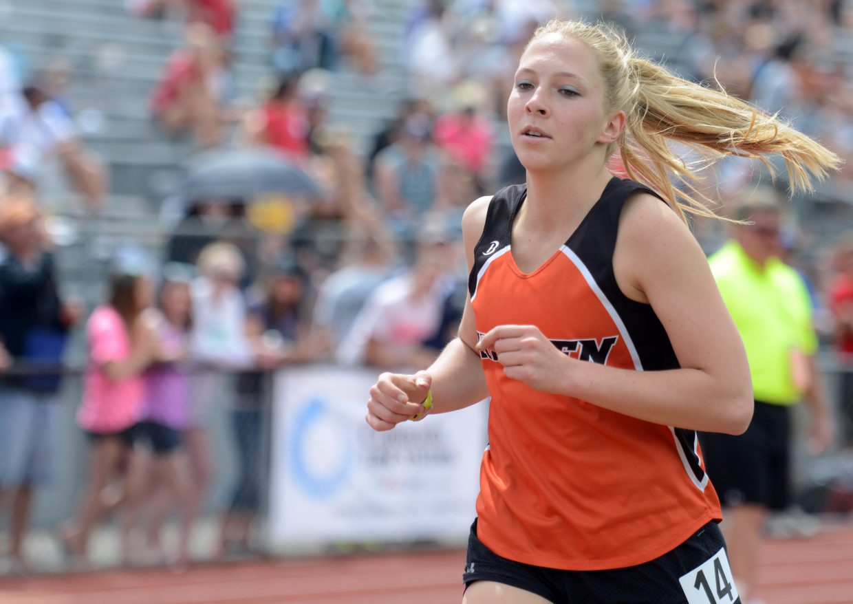 Hayden's Savannah Williams competes Saturday in the 1,600-meter run at the state track meet in Lakewood.