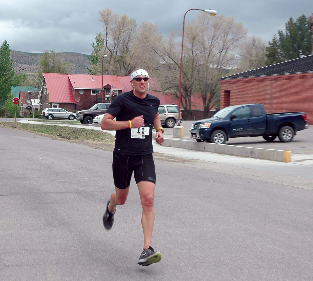 Rob Vermillion hits the home stretch during Saturday's Hayden Cog Run. Vermillion was the first finisher in the 8.4 mile run.
