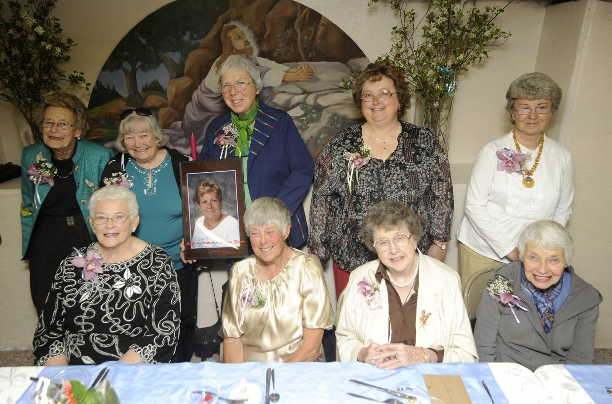 The women honored during Saturday's luncheon at St. Martin of Tours Church in Oak Creek were, clockwise from top left, Jane Weston, Ann Crawford, Rosemary Ferrell (holding a photo of the late Marilyn Goggin), Barb Gehl, Connie Sigler, Gisele Miller, Mary Maynarich, Virginia Rossi and Joann Lombardi.