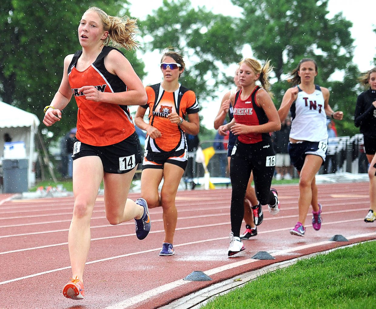 Hayden's Savannah Williams leads a pack of runners during Saturday's 1,600-meter run at the state track meet in Lakewood.