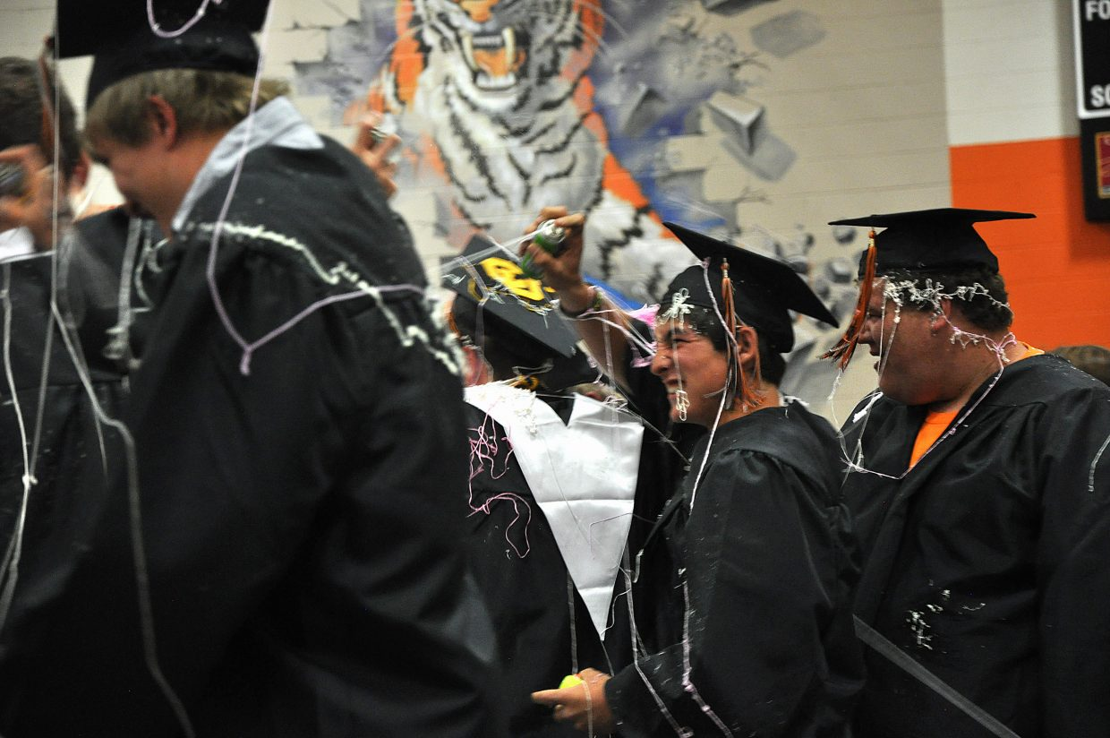 Graduates celebrate with a silly string war Sunday at Hayden High School.