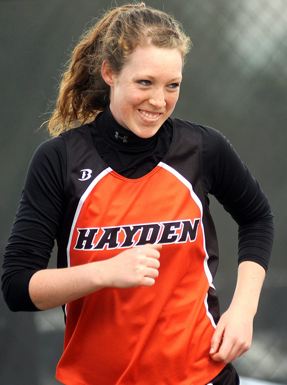 Hayden junior Aubree Haskins grins after her second throw in the Class 2A girls shot put finals Friday at the state track meet in Lakewood. Haskins claimed a state championship in the event.