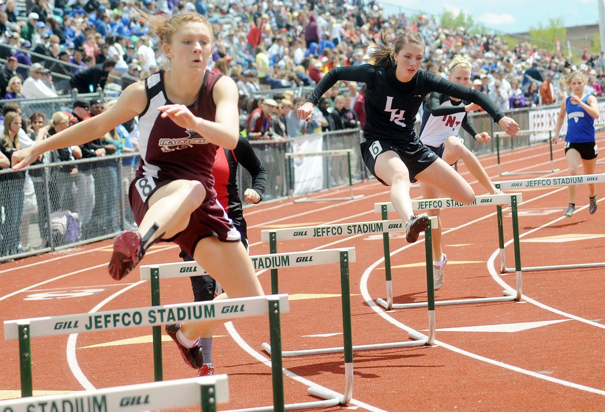 Micaela Meyer clears a hurdle in the 300-meter hurdles Friday at the state track meet in Lakewood.