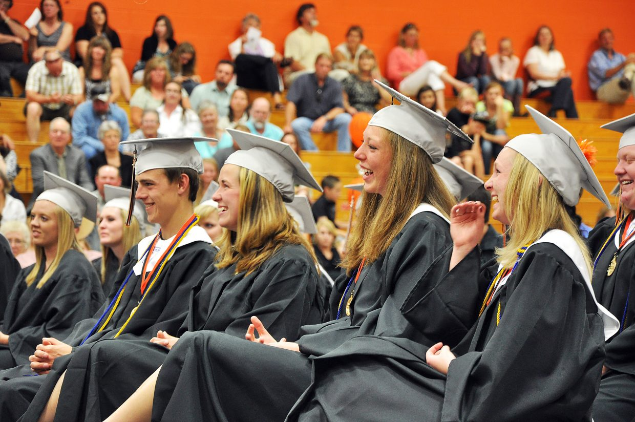Hayden graduates, from left, Brentt Gabel, Annie Grubbs, Aubree Haskins and McCoy Howe laugh Sunday while they listen to Mallory McGowen give the salutatorian address. The high school graduated 25 seniors in the ceremony.
