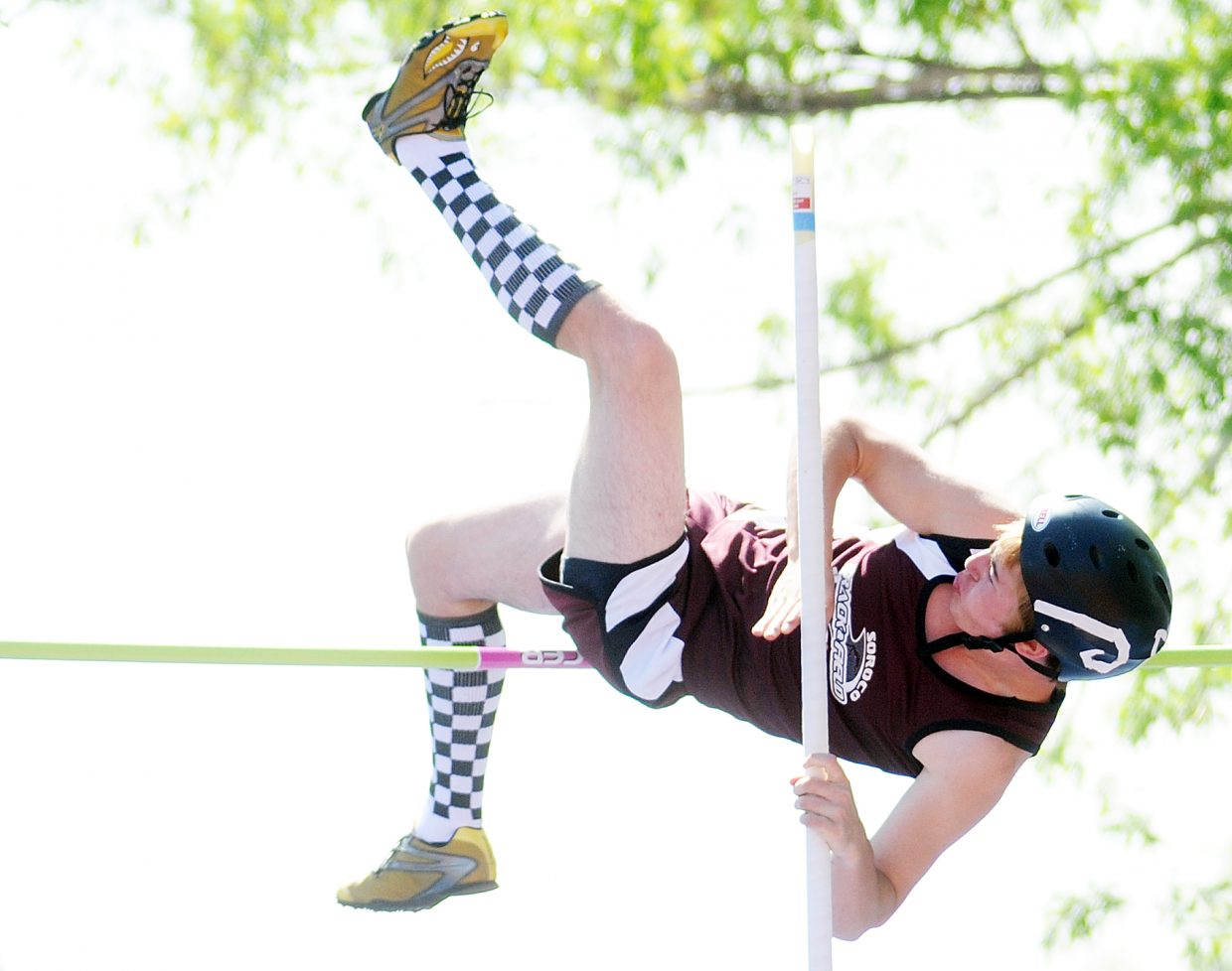 Soroco's Pie Lombardi tries to the clear the bar Friday in the pole vault at the state track meet in Lakewood.