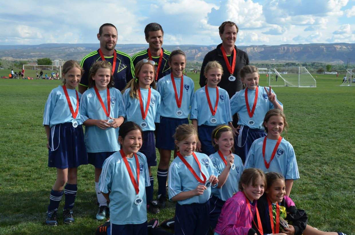 The U10 girls soccer team placed second in a tournament in Grand Junction last week. Pictured are, back row from left, Jason Waldschmidt, Bart Brown and Jason Foote; second to last row from left, Genevieve Gray, Lilli Armstrong, Hailey Moss, Jojo Vertrees, Bethany Leader and Bella Waldschmidt; second row from left, Ivy Gerber, Sydney O'Hare, Mollie Brown and Ella Chapman; front row from left, Josie Foote and Marissa Drobek.