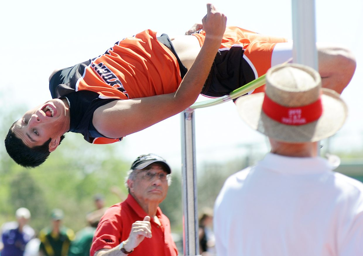 Hayden senior Rene Valdez tries to clear the bar Saturday at the state track meet in Lakewood. Valdez finished third in the event.