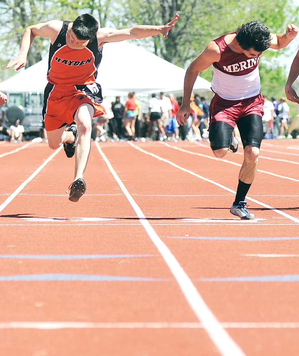 Hayden senior Jake Walker lunges across the finish line as he places second in the 100-meter dash at the state track meet in Lakewood. Walker finished 0.04 seconds behind the winner, Merino's Bryar DeSanti.