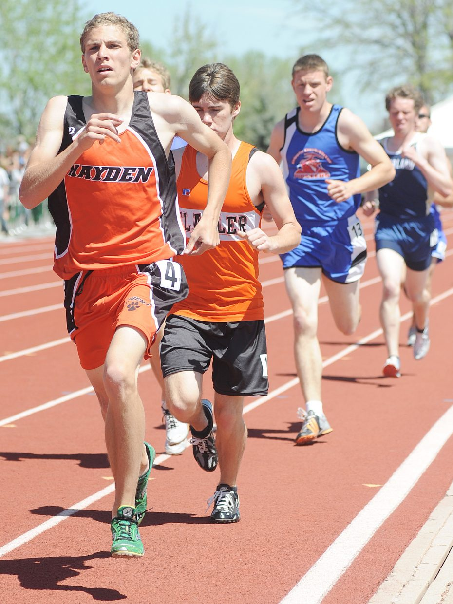 Chris Zirkle leads a pack of runners during the 1,600-meter run at the state track meet in Lakewood.