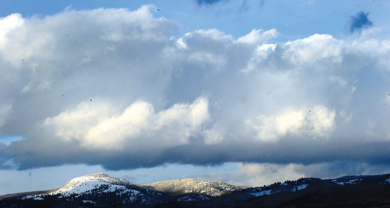 Clouds form over the mountains north of Steamboat Springs.