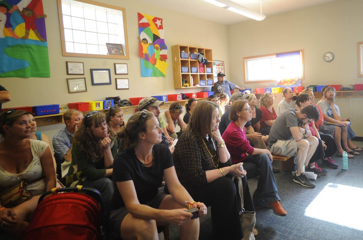 Parents of Laurel Street Preschool students listen to board members speak Thursday about their decision to close the school.