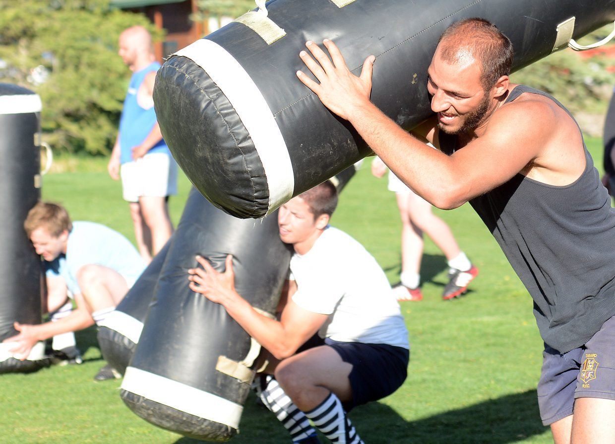 Jason Troyer hauls a bag during a conditioning drill at a rugby practice on Thursday in Steamboat Springs.