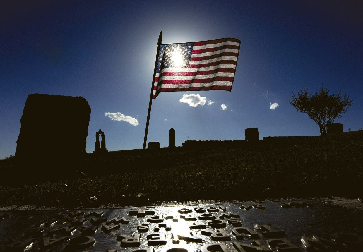 A flag honors a veteran at Steamboat Springs Cemetery.