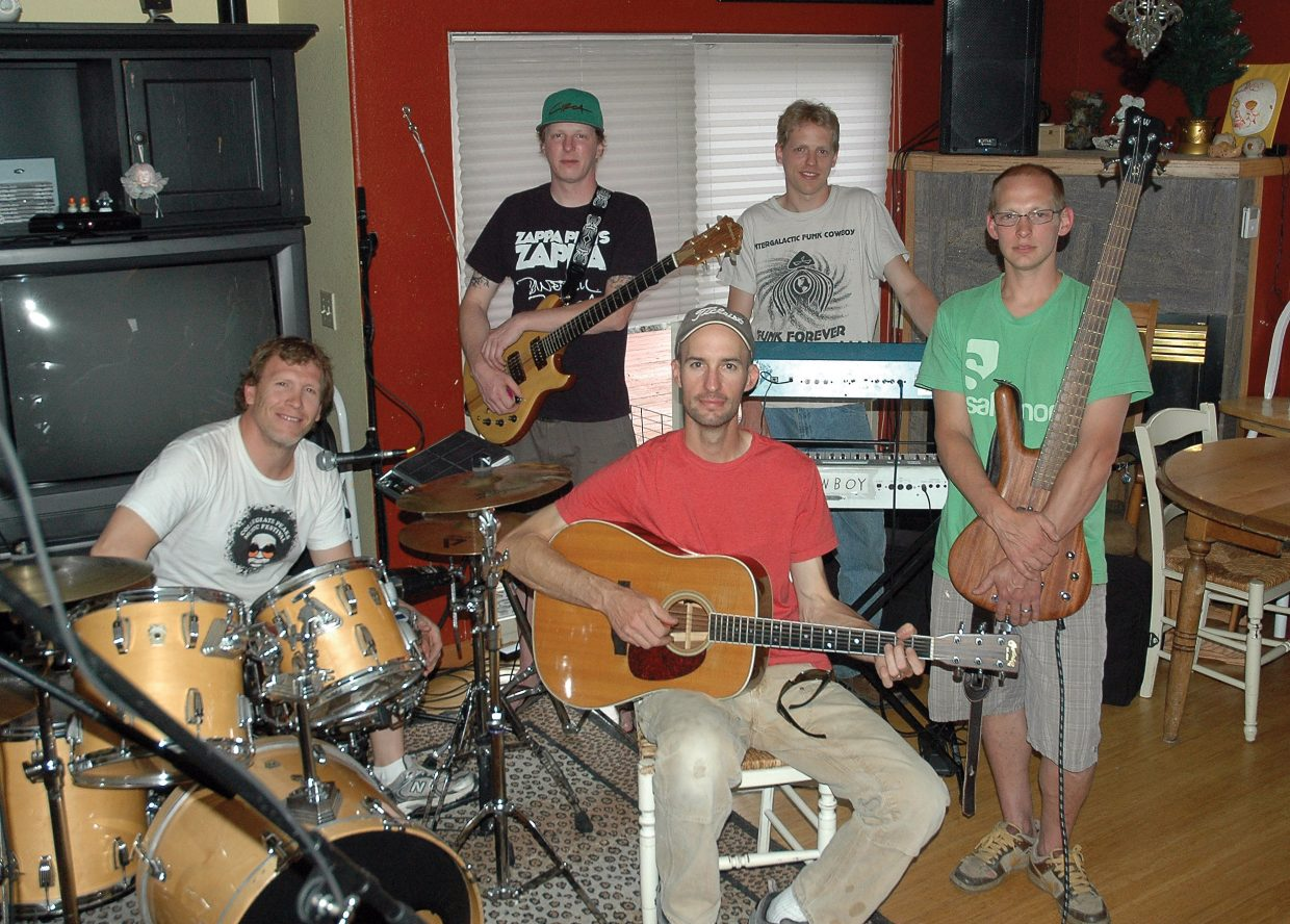 Pat Waters, clockwise from left, Dan Koebnick, Todd Leestma, Skip Warnke and Graham Waters take a break from rehearsal Tuesday for Wish You Were Pink, a Pink Floyd tribute taking place Sunday at Sweetwaer Grill.