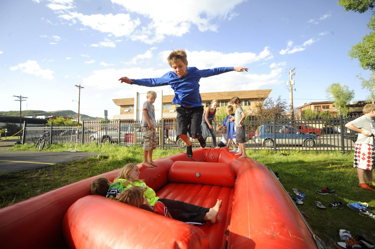 "Cole Gedeon, 10, of Steamboat Springs, plays on a raft during the Yampa River Festival registration party Friday at Backdoor Sports. Find a complete Yampa River Festival schedule <a href=""https://www.steamboatpilot.com/news/2012/may/22/yampa-river-festival-be-held-during-holiday-weeken/"">here</a>. The National Weather Service is forecasting a high of 77 degrees Saturday with winds as fast as 70 mph."