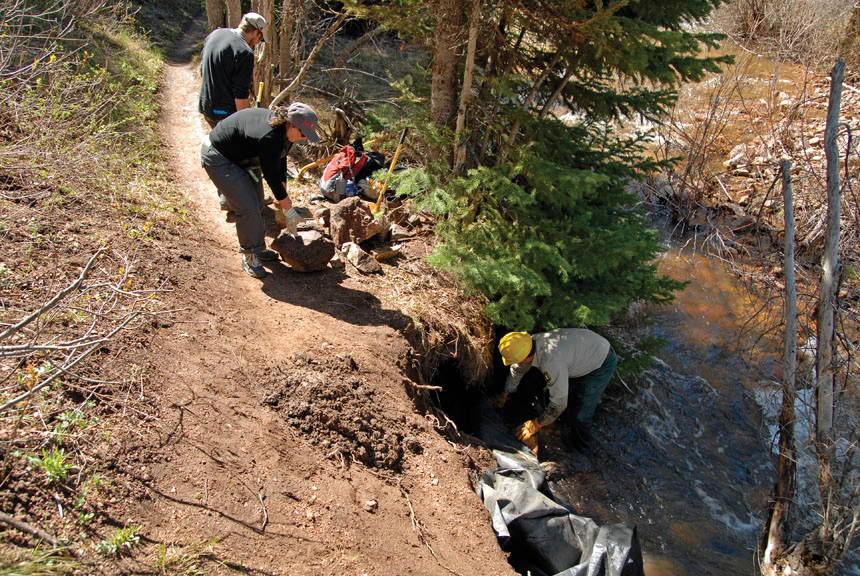 Routt County Riders volunteers and U.S. Forest Service employees spent a recent weekend improving the Hot Springs Trail. Here, they begin construction of a retaining wall to stabilize a section of trail that had collapsed into the creek.