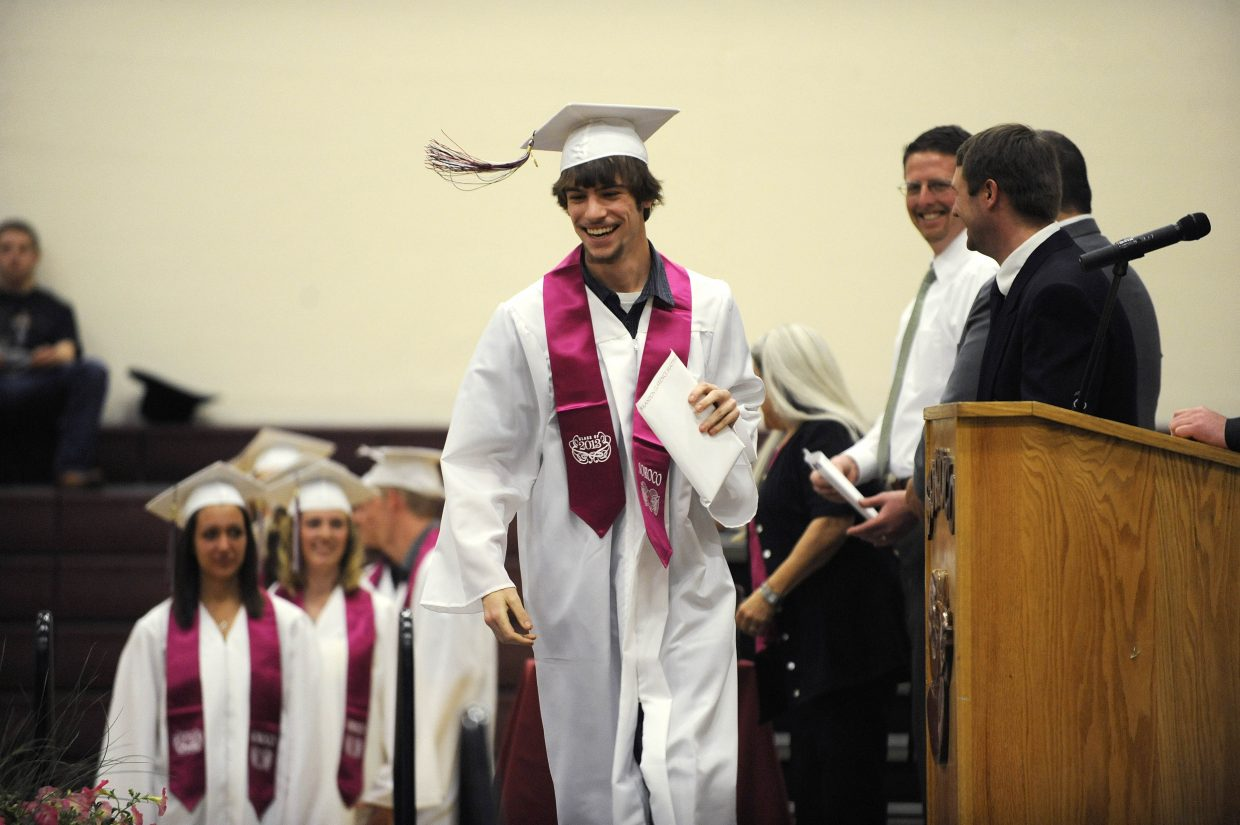 Brandon Matthews walks across the stage after receiving his diploma Saturday.