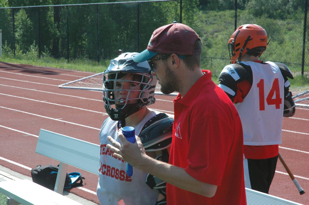 Andy Flax talks with a player Saturday during the Steamboat Classic Lacrosse Tournament. Andy, along with his brother Jake, has returned to Steamboat after a successful stint playing with Colorado State University. The two grew up in Steamboat playing lacrosse and have seen it grow to what it is today.