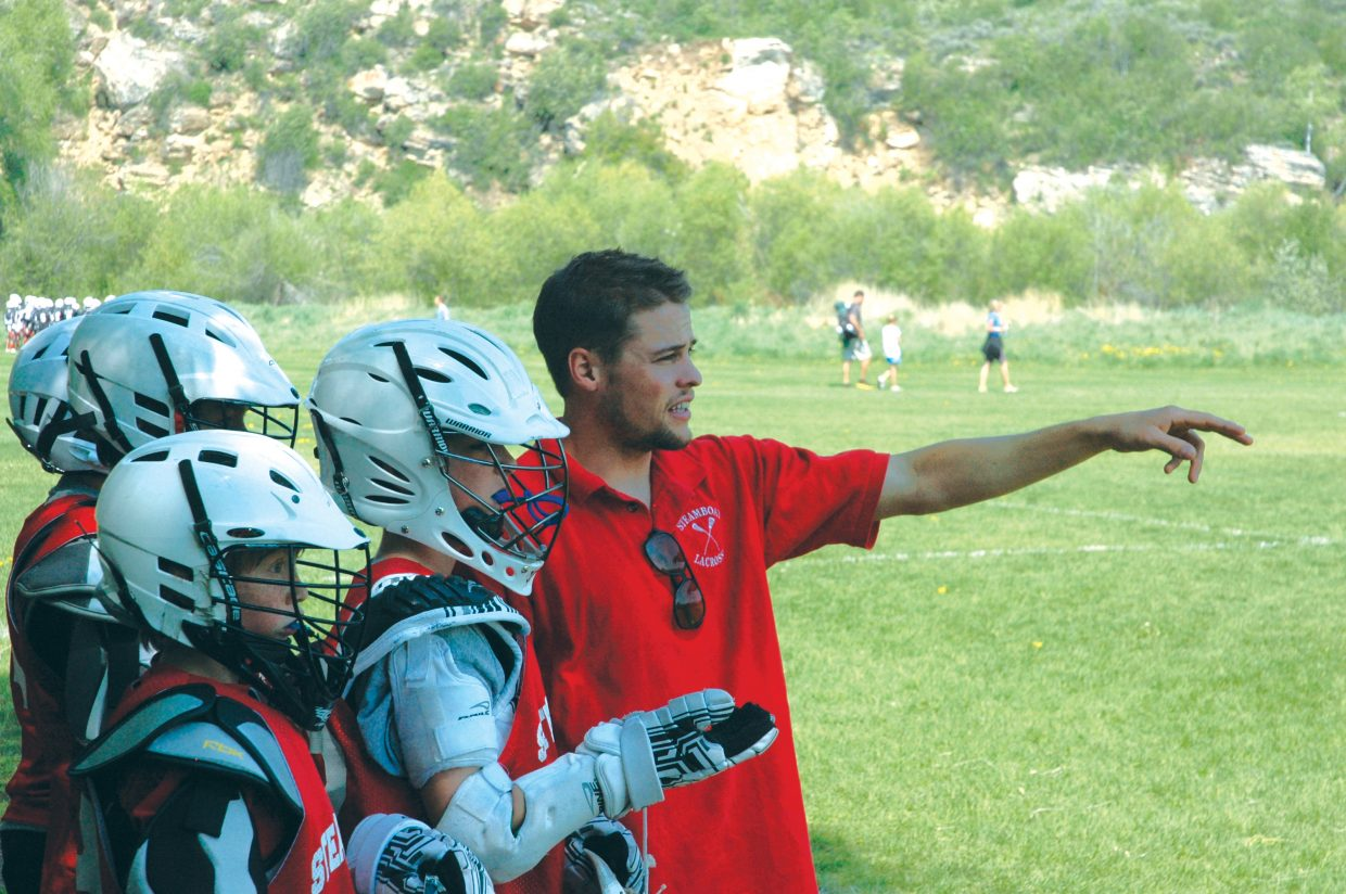 Jake Flax coaches a lacrosse game Saturday during the Steamboat Classic Lacrosse Tournament. He and his brother Andy have returned to Steamboat after successful careers at Colorado State University to help coach Steamboat Youth Lacrosse again.