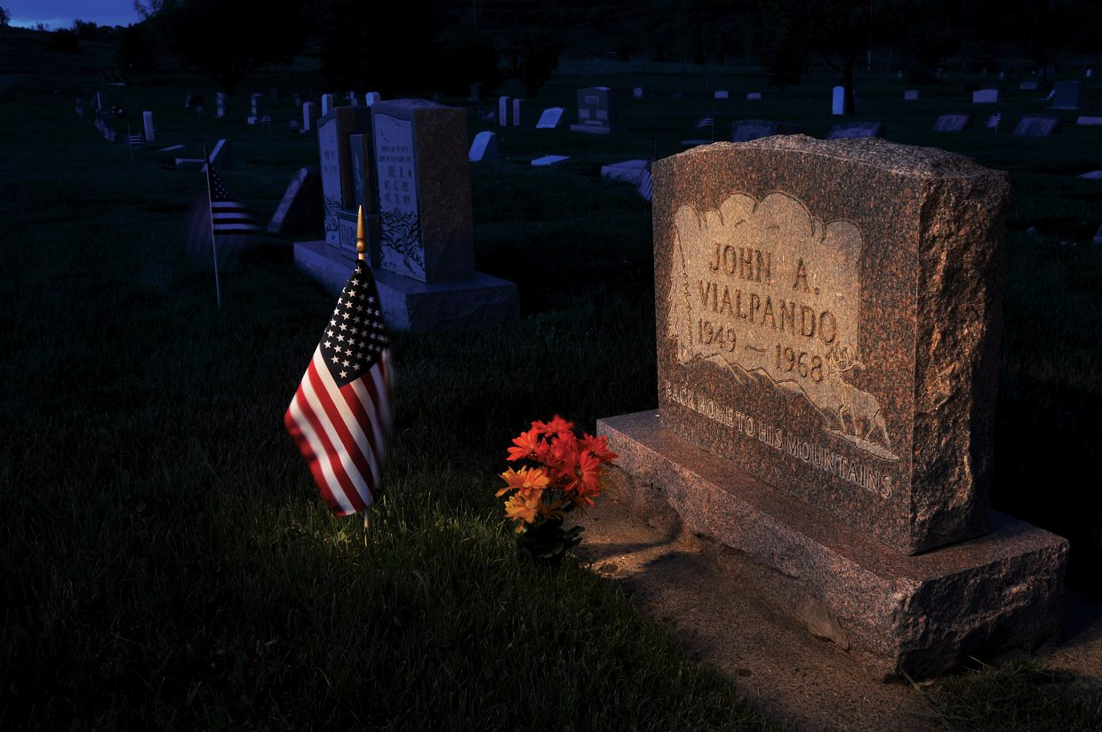 To mark Memorial Day, an American flag and flowers decorate the grave of John Vialpando in the Steamboat Springs Cemetery. Vialpando, a Steamboat Springs High School graduate, and David Fogg, a Soroco High School graduate, were killed in action in Vietnam as teenagers.