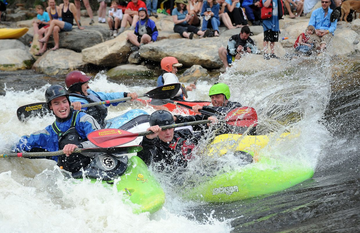 Kayakers crash into Charlie's Hole on Saturday after the freestyle rodeo during the Yampa River Festival in Steamboat Springs.