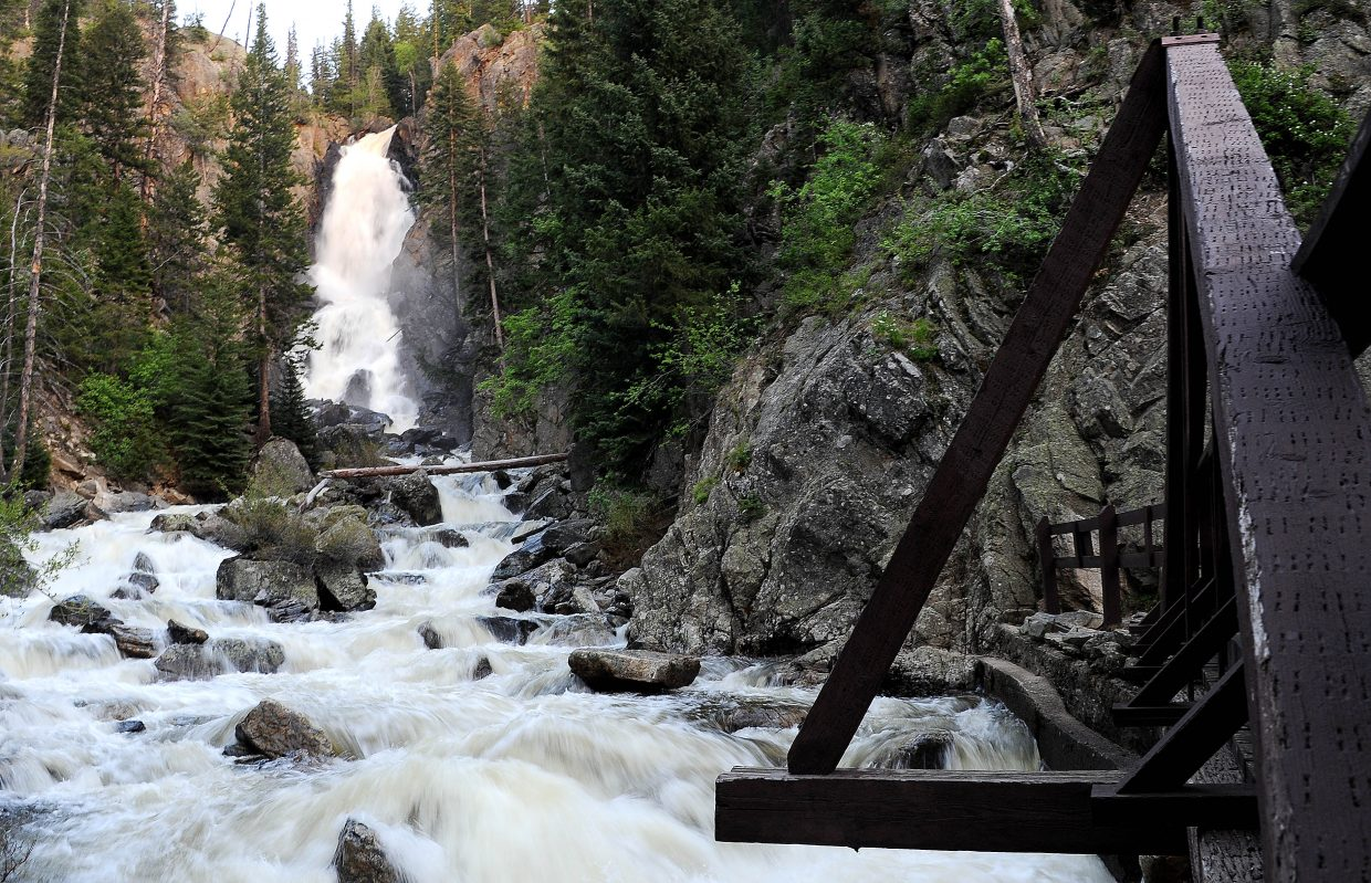 Photographing Fish Creek Falls from the pedestrian bridge can add to the sensation a viewer gets standing right above the rushing water.