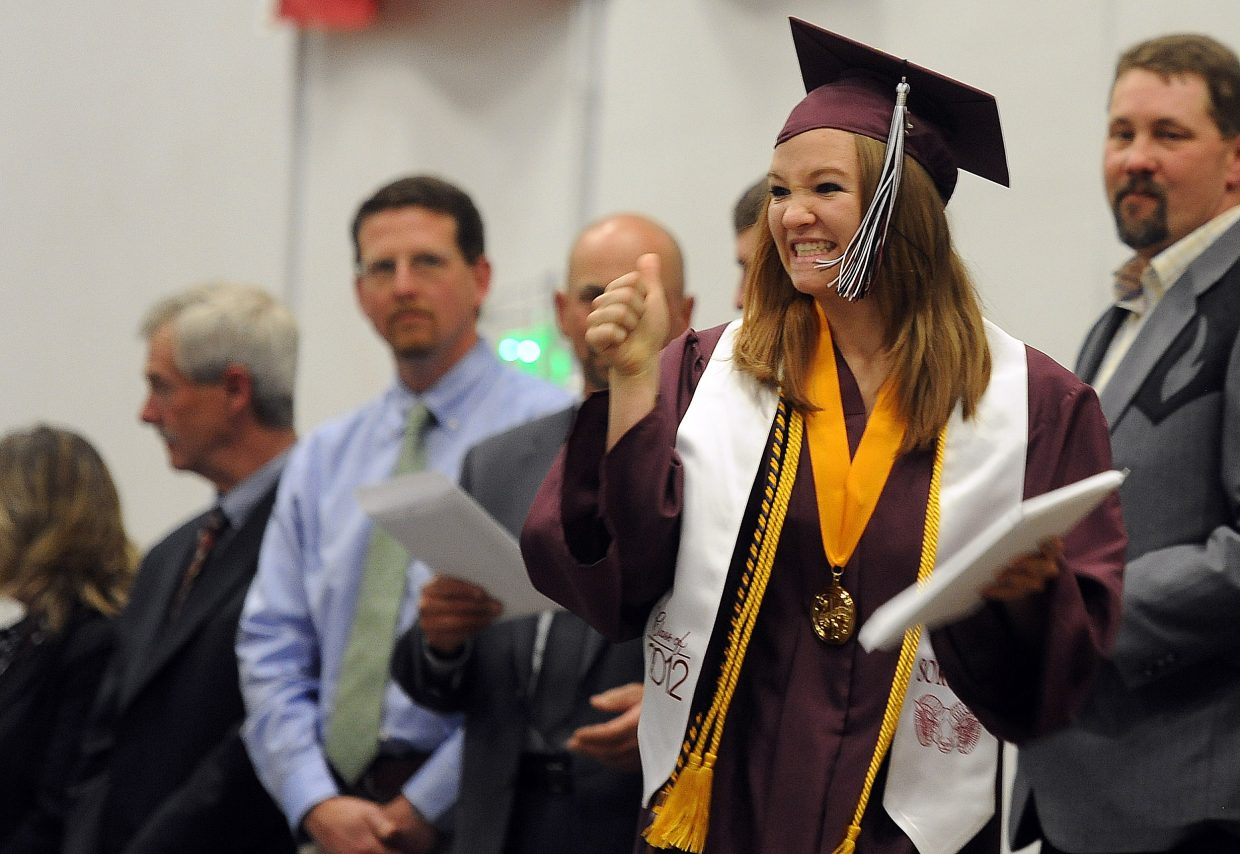 Soroco graduate Lauryn Bruggink celebrates after receiving her diploma Saturday in Oak Creek. Bruggink was the class valedictorian.