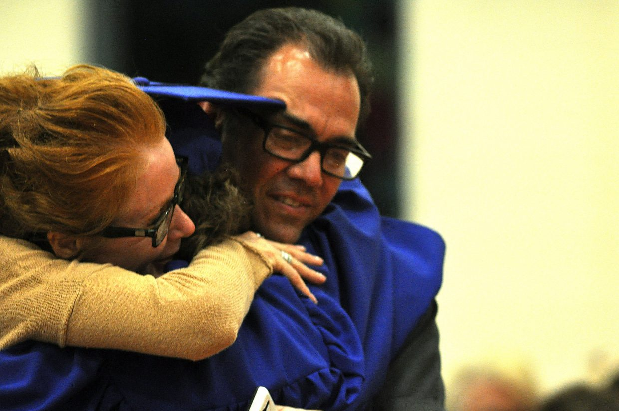 Graduate Kieran Buccino is hugged by his parents, Steven and Julie, on Sunday during the ceremony.