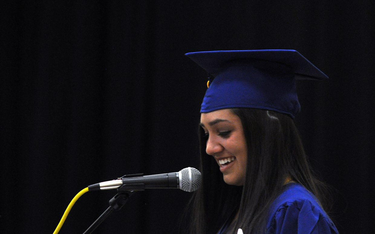 Shealie Jenkins delivers the valedictorian address Sunday at Heritage Christian School.
