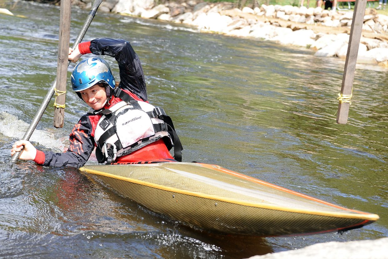 Louise Jull makes a turn Sunday during the Yampa River Festival's slalom competition.