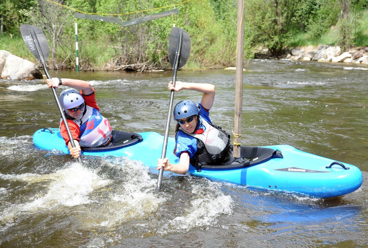 David Wallace and Betsy Frick cut a corner Sunday at the Yampa River Festival.