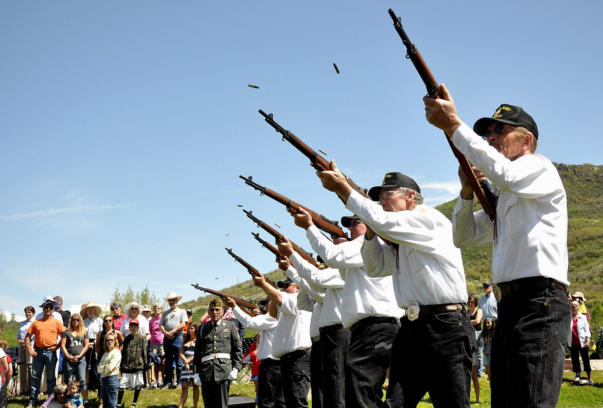 A rifle squad performs a 21-gun salute on Monday during the Memorial Day ceremony in Steamboat Springs. Attendee Vikki Franz said 10 years ago, the event attracted a modest crowd. Today, it has grown popular enough to warrant bus service from the city.