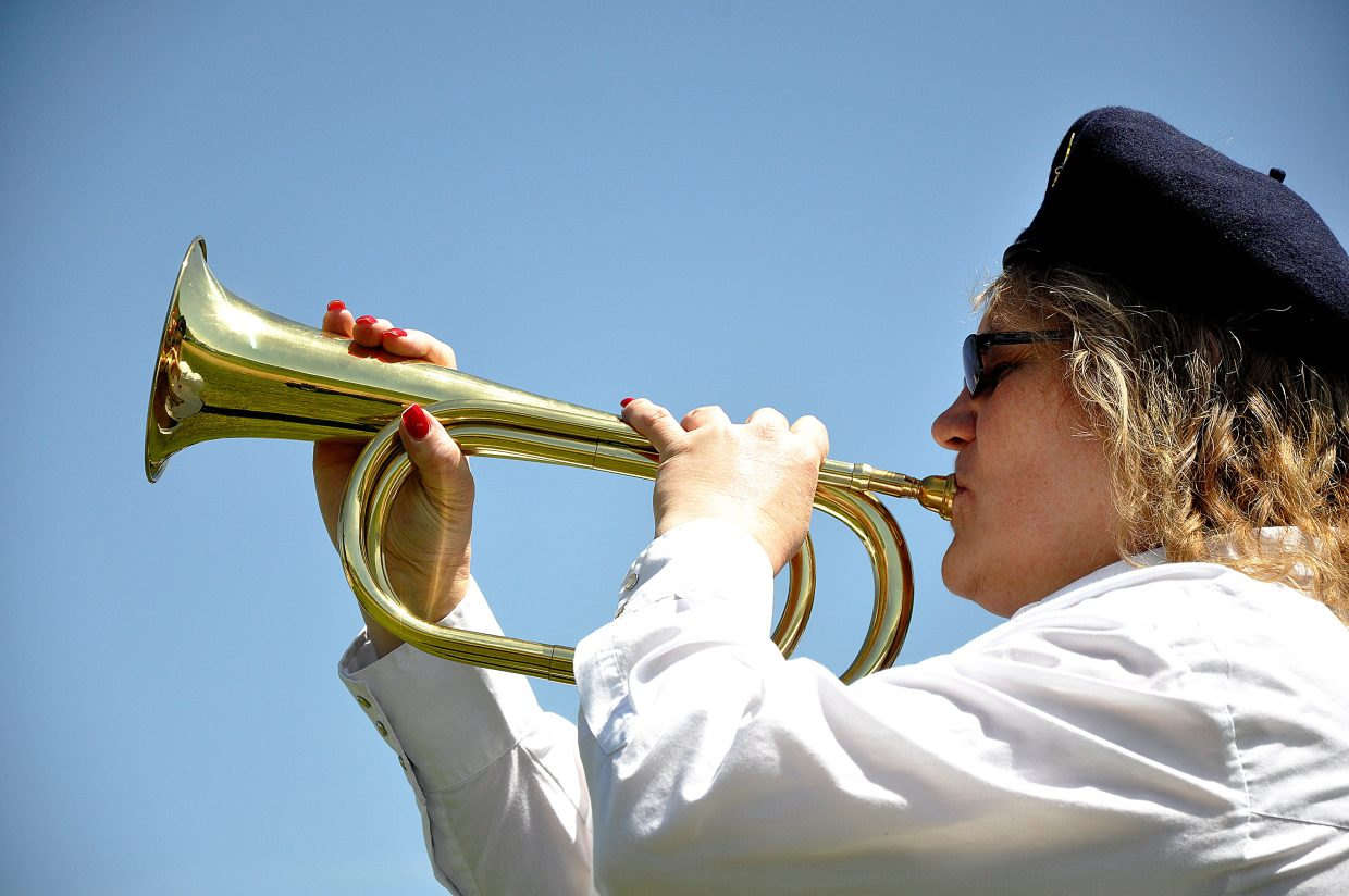 Valerie Bussey plays taps Monday during the Memorial Day ceremony in Steamboat Springs.