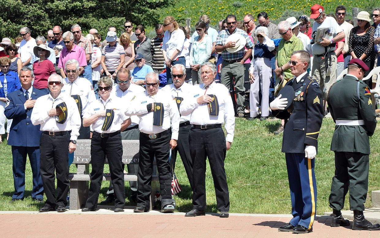 Veterans and community members pay tribute Monday to veterans of the Korean War during the Memorial Day ceremony in Steamboat Springs.